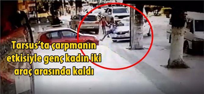 Tarsus'ta çarpmanın etkisiyle genç kadın iki araç arasında kaldı