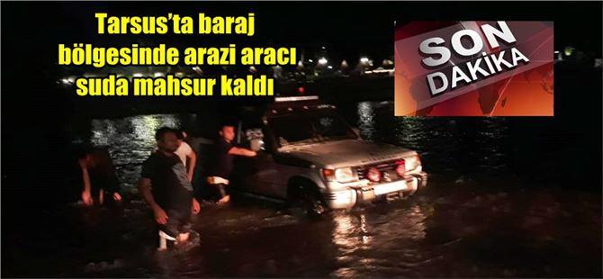 Tarsus'ta baraj bölgesinde arazi aracı suda mahsur kaldı