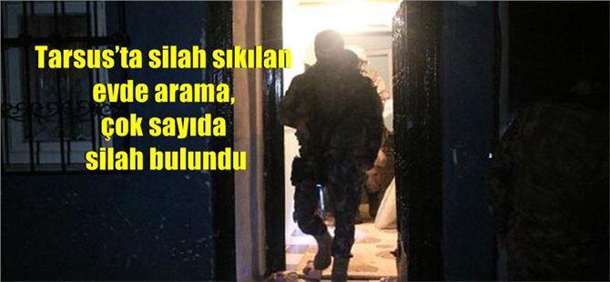 Tarsus'ta silah sıkılan evde arama, çok sayıda silah bulundu