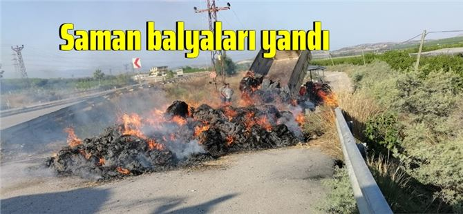 Tarsus'ta traktör arkasındaki saman balyaları yandı