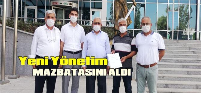 Mehmet Çelik başkanlığındaki MHP ilçe yönetimi mazbatasını aldı